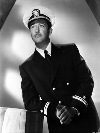 Robert Taylor posed in Navy Uniform