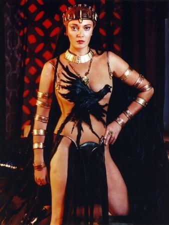 Sarah Douglas Posed in Crow Printer Dress with Gold Bracelets