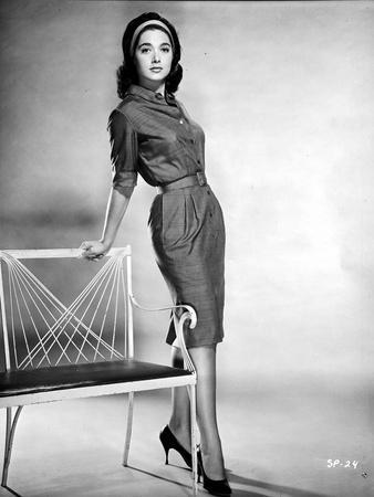 Suzanne Pleshette Leaning on a Chair and wearing a Dress
