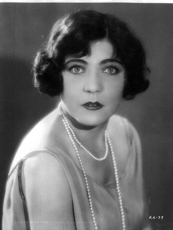 Rene Adoree on a Pearl Necklace and posed