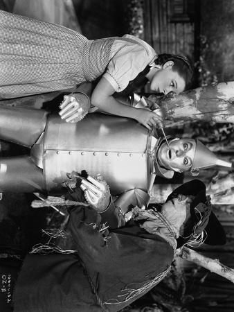 Wizard Of Oz Dorothy Helping Tin Man with Scarecrow in Movie Scene- Photograph Print