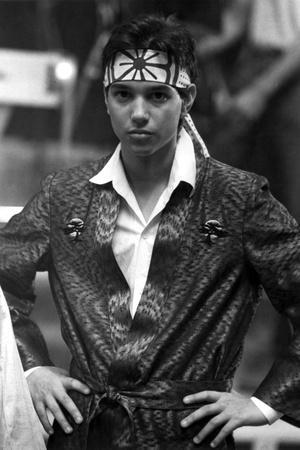 Ralph Macchio in Glossy Suit With Headband