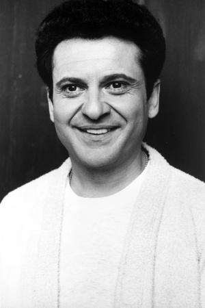 Joe Pesci smiling in White Shirt