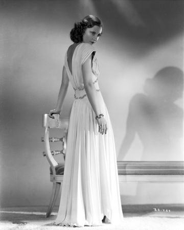 Barbara Stanwyck Showing Her Back in Long White Gown