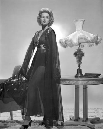 Angie Dickinson standing wearing Dress Black and White