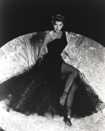 Ava Gardner posed in Long Black Gown with Stockings and Stiletto