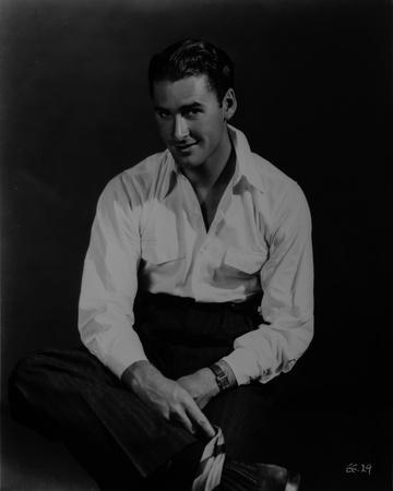 Errol Flynn sitting on the Floor wearing White Long Sleeve