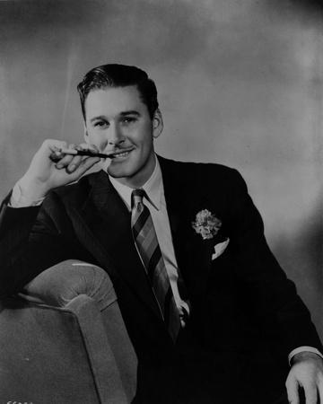Errol Flynn Seated in Tuxedo