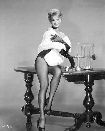 Angie Dickinson sitting on Table in Sexy Outfit Black and White