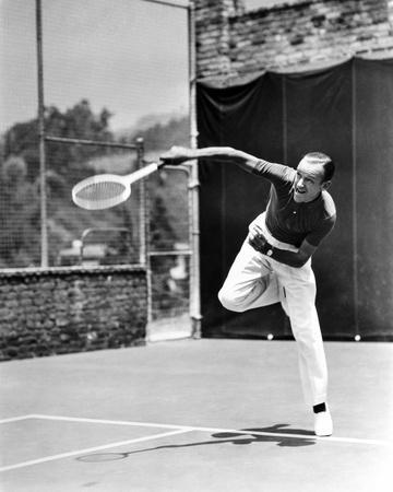 Fred Astaire Serving Ball in Tennis