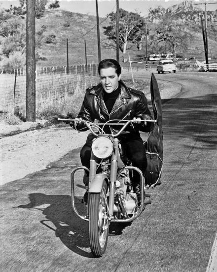 Elvis Presley Riding in Classic