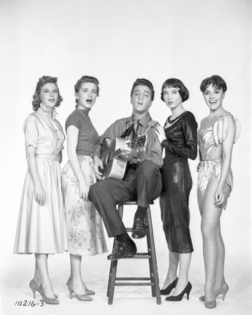 A portrait of Elvis Presley and backup singers.