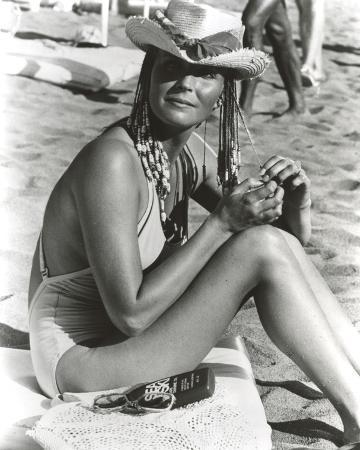 Bo Derek on Sand in Swimsuit with Hat