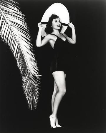 Paulette Goddard Posed wearing Black Bikini with Hat Portrait with Black Background