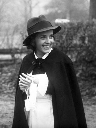 Jeanne Moreau Portrait in White Blouse and Black Linen Mantle with Brimmed Hat