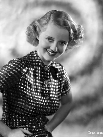 Bette Davis Portrait Hands on the Waist in White Polka Dot Black Short Sleeve Dress