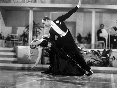 Fred Astaire and Ginger Rogers Dancing in Black Dress and Black Tuxedo with Audience Watching