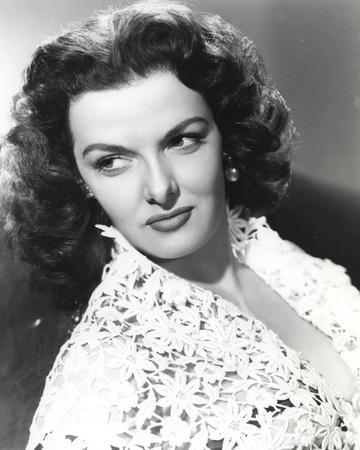 Jane Russell Portrait in White Floral Lace Dress while Leaning Back and Looking to the Right