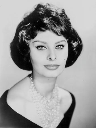 Sophia Loren wearing a Scoop-Neck Dress with Necklace in a Close Up Portrait
