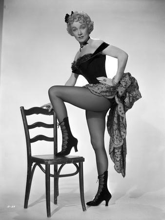 Marlene Dietrich standing One Leg in Black Lingerie with One Leg Stepping on Chair