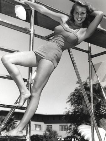 Janet Leigh Posed on the Steel Ladder in Grey Silk One Piece Swimsuit