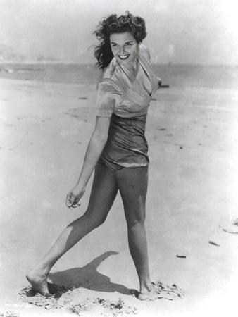 Jane Russell Posed in Silk Short Sleeve Shirt and Shorts while Walking on the Beach Sand