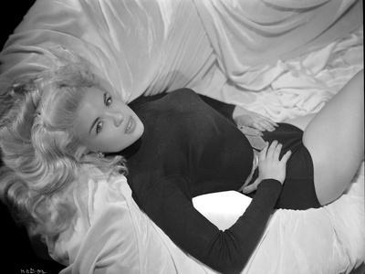 Jayne Mansfield Posed in Black Long Sleeve High Neck Shirt and Leather Waist Belt