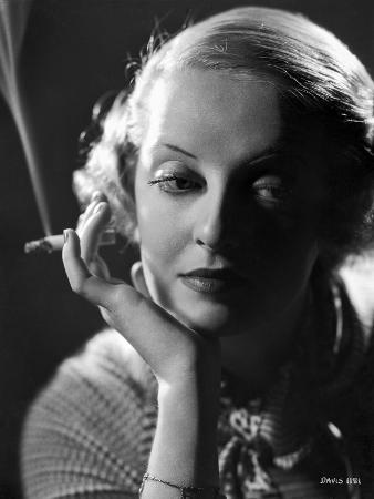Bette Davis Portrait Chin Leaning on Hand with Cigarette in White Knitted Shirt