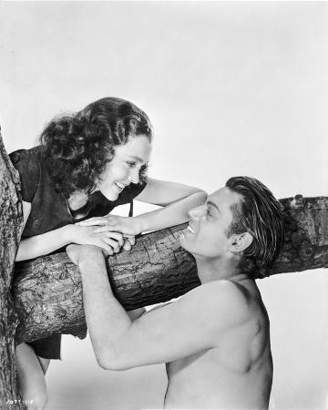 Johnny Weissmuller Talking to a Woman on Top of a Tree in a Classic Movie Scene