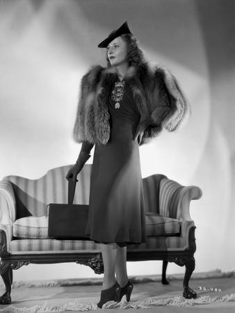 Barbara Stanwyck posed in Portrait wearing Elegant Dress and Furry Coat