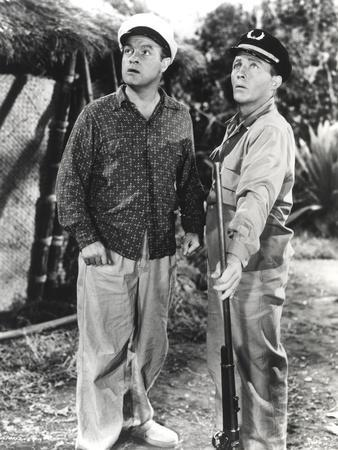 Bob Hope standing and Looking Up with Man in Police Uniform
