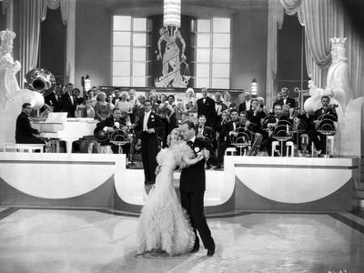 Fred Astaire and Ginger Rogers Dancing with Musical Orchestra Behind Them