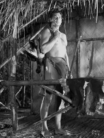 Johnny Weissmuller standing Outside on His House in a Classic Movie Scene