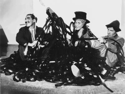 Marx Brothers Scene with Three Men smiling in Black and White