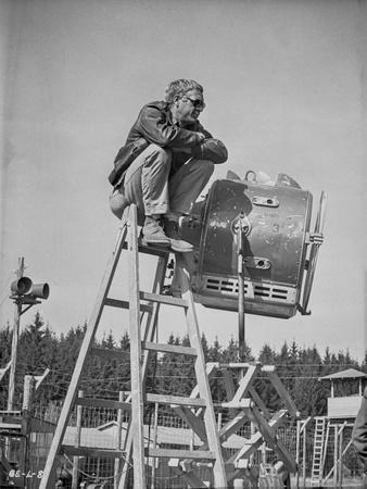 Steve McQueen Seated on Ladder Scene Excerpt from Film in Black and White