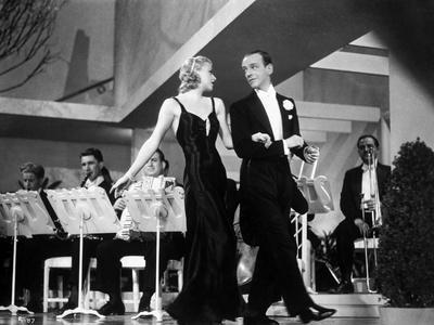 Fred Astaire and Ginger Rogers Walking in Front of Orchestra