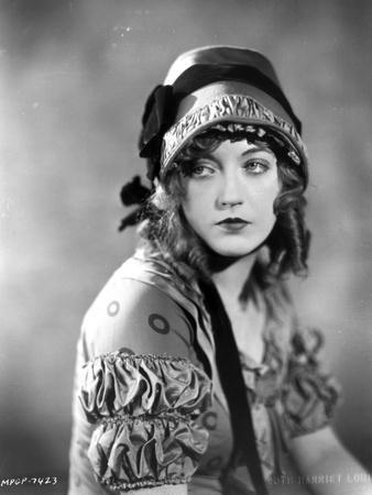 Marion Davies posed in Blouse and Ribbon Hat in Black and White