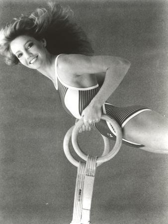 Heather Locklear in a Swimsuit Holding a Gymnastic Equipment
