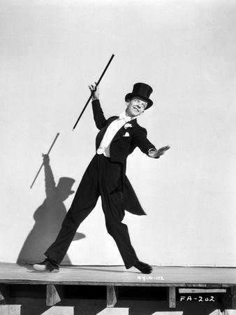 Fred Astaire Dancing in Tuxedo and Top Hat in Black and White