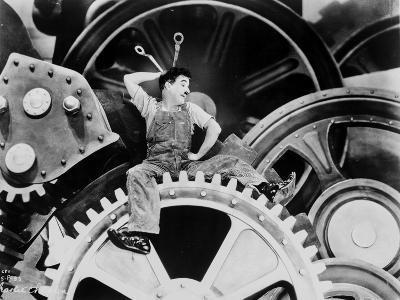 Charlie Chaplin sitting on Big Metal in Modern Times Movie Scene