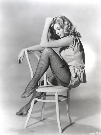 Anita Ekberg sitting on a Chair in a Classic Portrait
