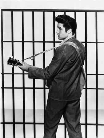 Elvis Presley Looking Back and Playing Guitar in Classic