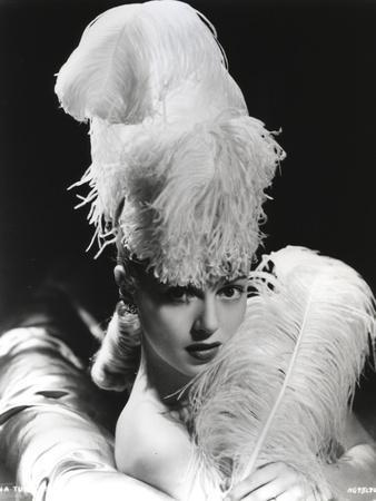 Lana Turner posed in Feathery Dress with Black Background