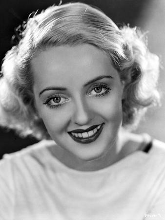 Bette Davis Portrait smiling in White Dress on Black Background
