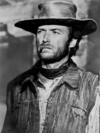 Clint Eastwood Looking Away in Cowboy Attire with Cigarette in His Mouth