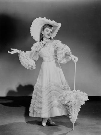 Judy Garland fancy in dress hat and umbrella +tograph High Qua...