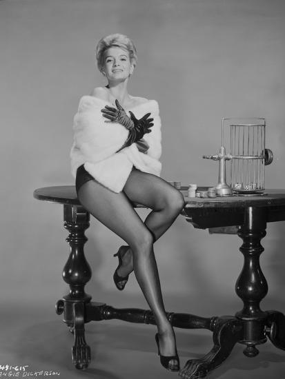 'Angie Dickinson sitting on Table in Sexy Outfit with White Coat' Photo - Movie Star News ...