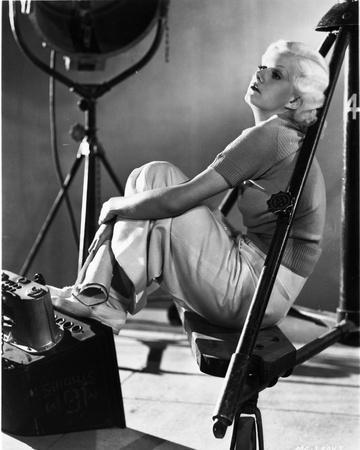Jean Harlow Seated Knees Bent in Black Shirt and White Skirt