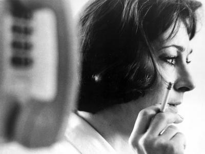 Anjelica Huston Smoking Near a Payphone in Classic Portrait