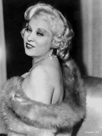 Mae West Posed Sideways in Fur Coat with a Little Smile